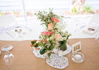 Rustic Pink and Peach Centerpieces on Burlap Runner