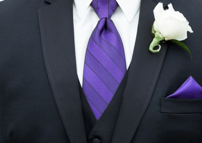 White Groom Boutonniere with Purple Tie
