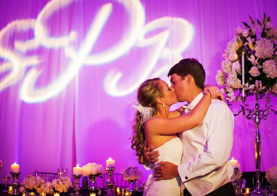 Tall Wedding Centerpieces with Purple Uplighting