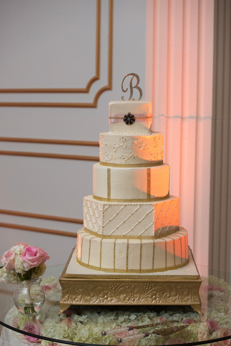 Five Tier, Ivory Wedding Cake with Gold Accents and Monogrammed Initial Cake Topper