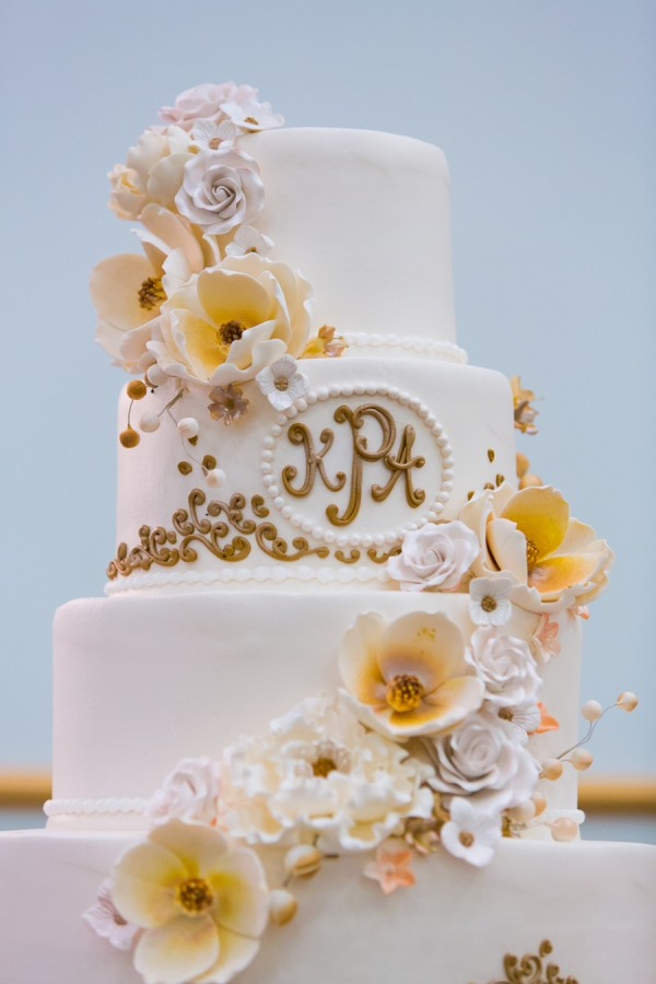 Three Tiered Ivory and Gold Wedding Cake with Floral Accents