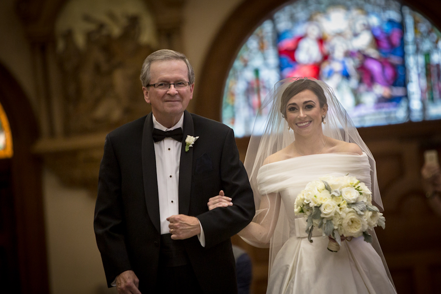 Bride and Dad Walking Down the Aisle at Church Wedding Ceremony