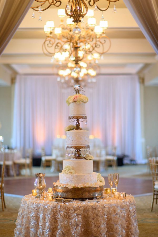 Elegant 4-Tier Round White Wedding Cake with Flower Petals