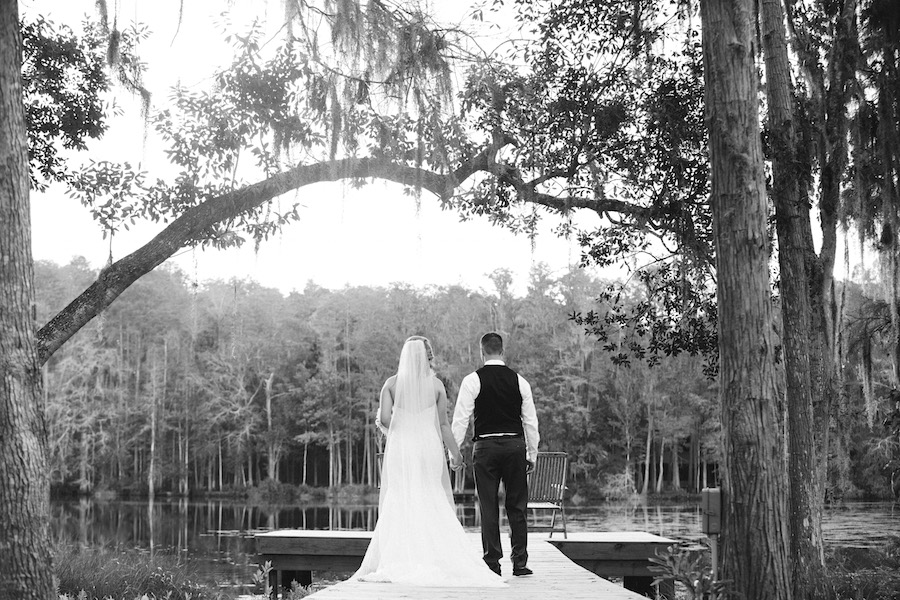 Outdoor Lakeside, Waterfront Bride and Groom Tampa Bay Wedding Portrait Under Spanish Moss | Wedding Florist Northside Florist