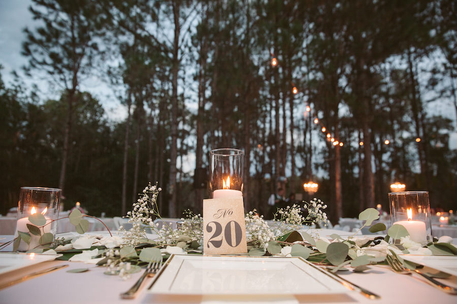 Rustic Wedding Table Dressing with Baby's Breath, White Candles and Greenery on Light Pink Tablecloths with Gold Accent | Tampa Bay Wedding Floral Designer Northside Florist