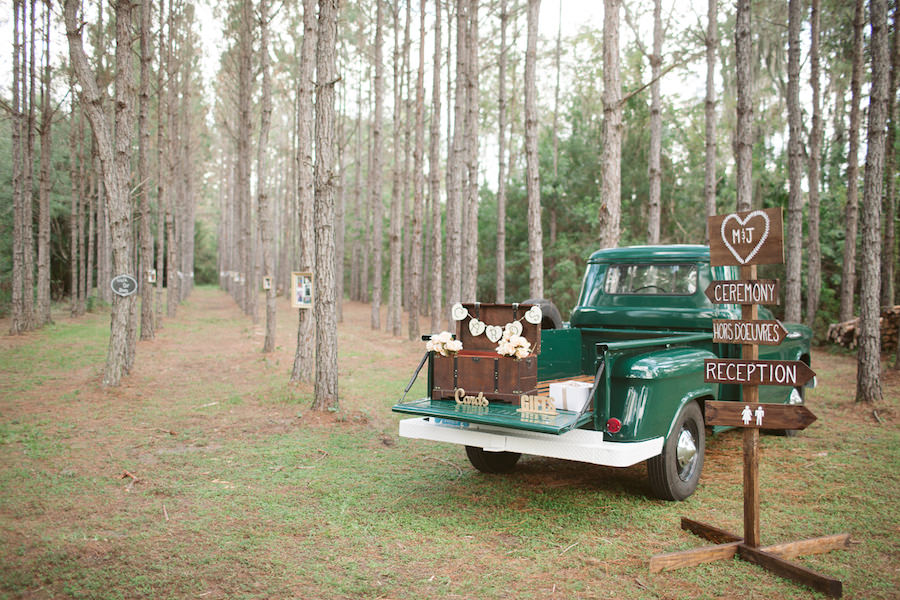 Rustic Outdoor Wedding Directional Sign with Vintage Trunk for Wedding Gifts on Green Vintage Pick Up Truck | Tampa Wedding Floral Designer Northside Florist